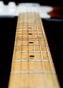 Check for frets that look out of alignment