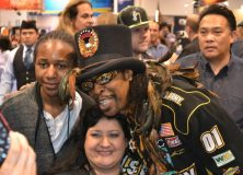 "Bootsy ""Bootzilla"" Collins posing with fans."