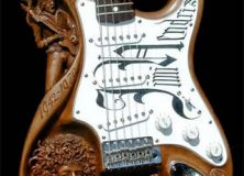 Carved Guitars:  Carved By Their Hands To Fit In Yours